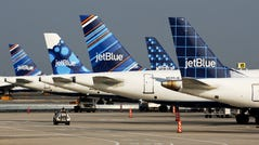 JetBlue planes parked side by side.
