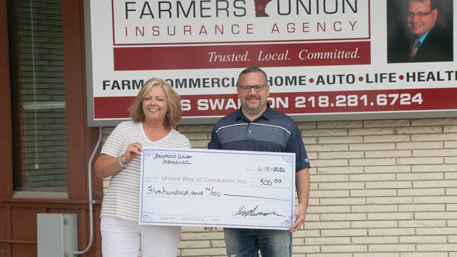 Crookston Farmers Union Insurance agent Chris Swanson is pictured presenting a $500 donation to United Way of Crookston Executive Director Lori Wagner.