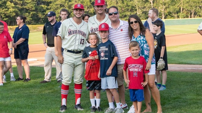 Players Mike Ludowig, far left, and Nick Zwack, of the Harwich Mariners, pose with the O'Leary family, who hosted them during the 2019 Cape Cod Baseball League season. Melissa O'Leary, right, said a highlight of hosting the players was giving them an authentic Cape Cod experience.