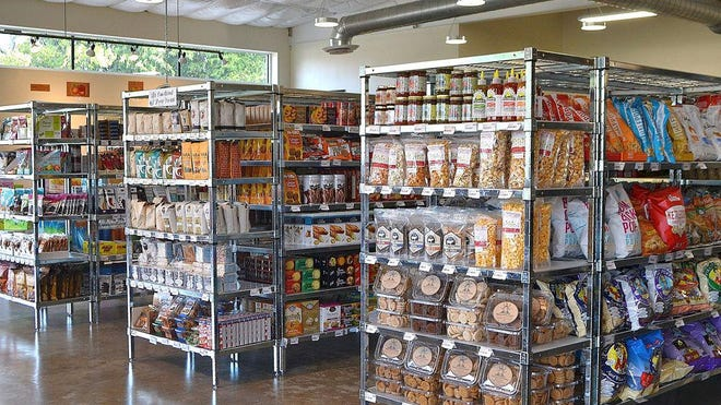 Dia's Market is one of a growing number of neighborhood markets that serve customers who want to pick up a few groceries, grab a bite to eat and a drink.