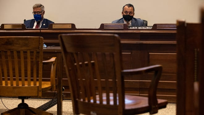 State Sen. Michael Rodrigues, D-Westport, and state Rep. Aaron Michlewitz, D-Boston, the Legislature's budget-writing chieftains, listened to virtual testimony from economic experts Wednesday in a near-empty Statehouse hearing room as they prepared to revisit the fiscal 2021 general budget.