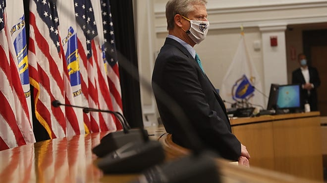 Gov. Charlie Baker stands during a recent press conference.