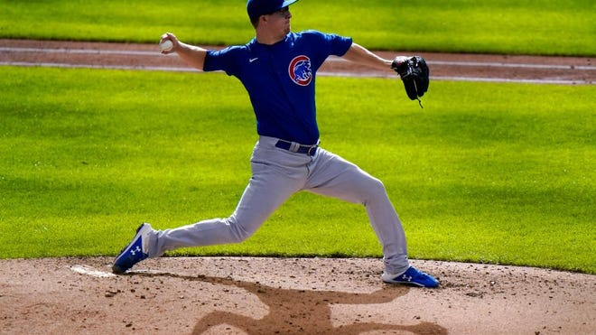 Chicago Cubs starting pitcher Alec Mills throws during the eighth inning against the Milwaukee Brewers on Sunday in Milwaukee.