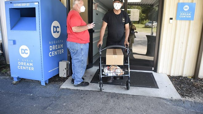 Vietnam veteran Birden Howard walks to his car after picking up a box of food at the Dream Center in Augusta, Ga., Tuesday morning July 14, 2020.