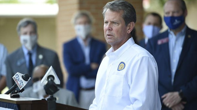 """FILE - Georgia Gov. Brian Kemp's """"Wear a Mask"""" Fly-Around Tour made a stop at the Georgia Cancer Center in Augusta, Ga., Wednesday morning July 2, 2020, to promote the wearing of masks as COVID numbers rise in Georgia."""