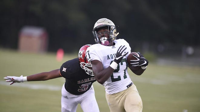 Darius Stone runs past a Harlem defender on Friday evening September 4, 2020.  Stone is this week's player of the week.