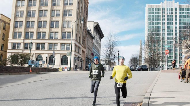 Runners compete in the New Year's Resolution run held on Jan. 1, 2020, in downtown Asheville.