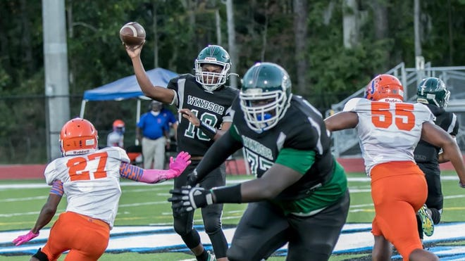 """Windsor Forest's """"Big"""" Joe Maxwell (No. 77) blocks for quarterback Dalen Jacobs in a win over Johnson last Friday night. On Sunday, Maxwell committed to play at Delaware State."""