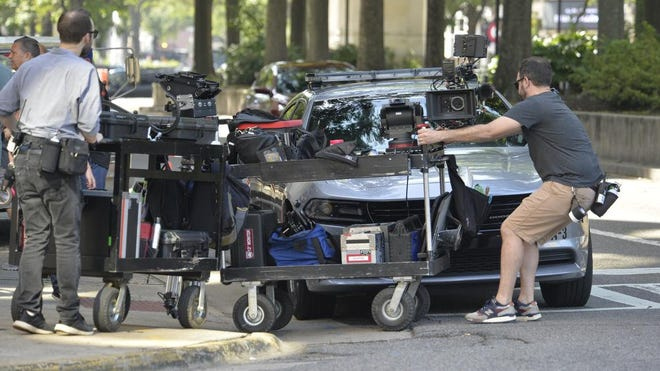 Workers prepare for the filming of the Clint Eastwood movie, The Mule, along Broad Street Wednesday morning June 6, 2018 in downtown Augusta, Ga.