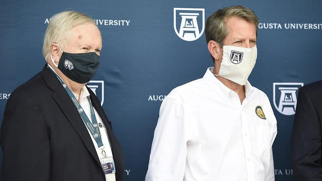 """Augusta University President Dr. Brooks Keel, left, and Georgia Gov. Brian Kemp during the """"Wear a Mask"""" Fly-Around Tour at the Georgia Cancer Center in Augusta, Ga., Wednesday morning July 2, 2020, to promote the wearing of masks as COVID numbers rise in Georgia."""