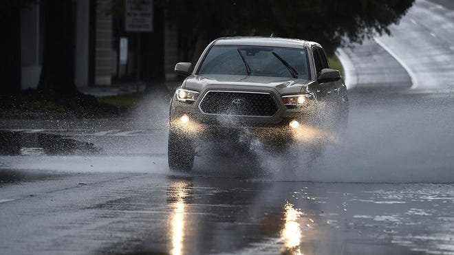 Vehicles send water flying as they get off the Calhoun Expressway after the remnants of Hurricane Sally passed over Augusta, Ga., Thursday morning Sept. 17, 2020