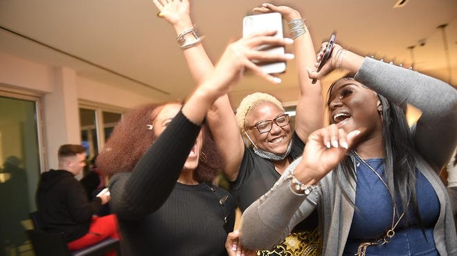 Richmond County Board of Education District 1 candidate Shawnda Griffin, middle, celebrates her victory with supporters at the Hyatt House Hotel in Augusta, Ga., Tuesday evening November 3, 2020.