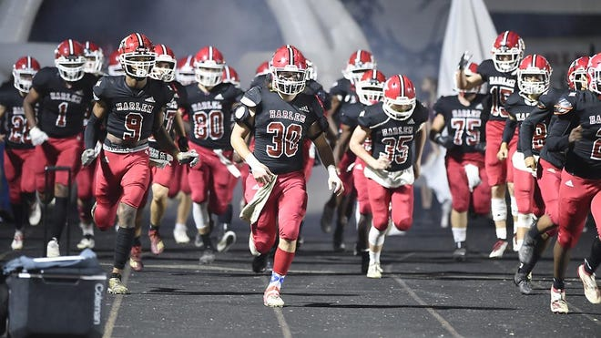 The Harlem High School football team takes to the field to take on Burke County at Harlem High School in Harlem, Ga., Friday evening October 23, 2020.