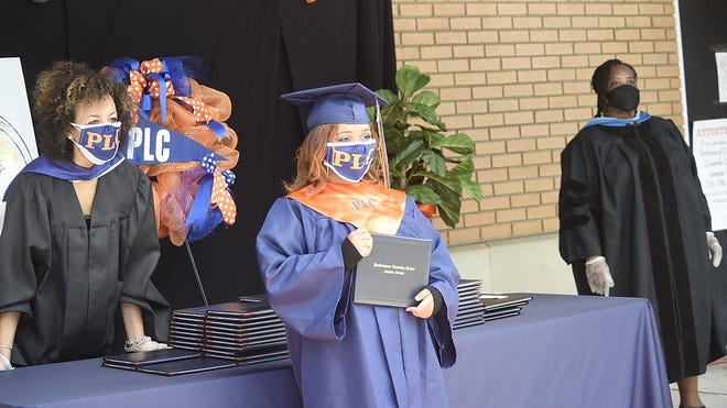 The Richmond County School System held drive-through graduation ceremonies for Performance Learning CenterÕs Class of 2020 at the Performance Learning Center campus in Augusta Thursday afternoon, July 23, 2020.
