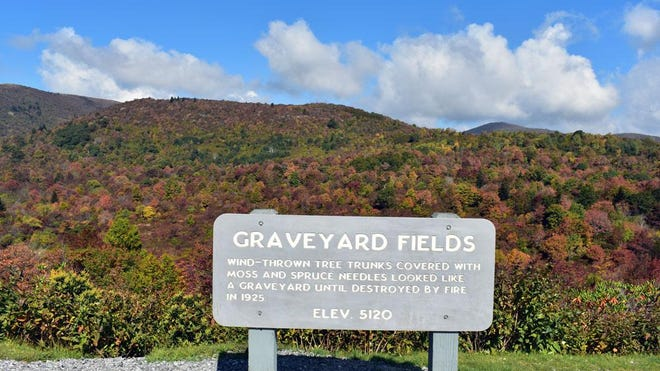 In this Sept. 21, 2017 photo, fall colors are vivid and bright at Graveyard Fields off the Blue Ridge Parkway.