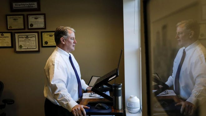 William Cadigan, a member of the Illinois Board of Elections, joins in on a virtual meeting Friday to certify the vote while at his office in Winnetka.