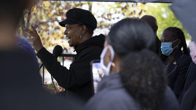 State Rep. Camille Lilly speaks during a news conference outside of Mercy Hospital in Chicago on Oct. 23. She chairs the House Black caucus.