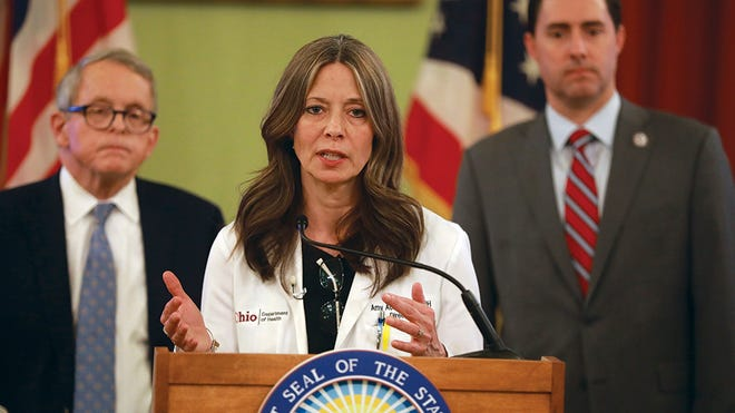 Ohio Department of Health director Dr. Amy Acton at a coronavirus news conference Saturday, March 14, 2020 at the Ohio Statehouse. Behind her is Ohio Gov. Mike DeWine (left) and Secretary of State Frank LaRose.