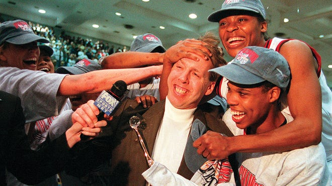 Columbus Quest coach Brian Agler celebrates with players after the team won the ABL championship game in 1998.
