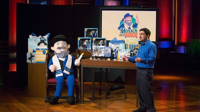 """Neal Hoffman makes his presentation on ABC's hit reality television show """"Shark Tank"""" in 2014."""