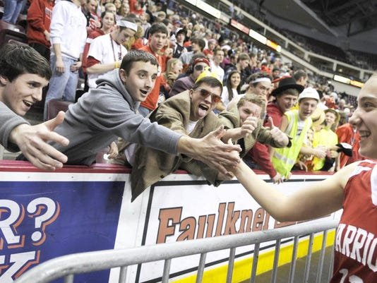 Fans high-five Jeanette Wilson after Susquehannock defeated West York in the District 3 Class AAA semifinals. The Warriors will play Palmyra today for a shot at their first district title.