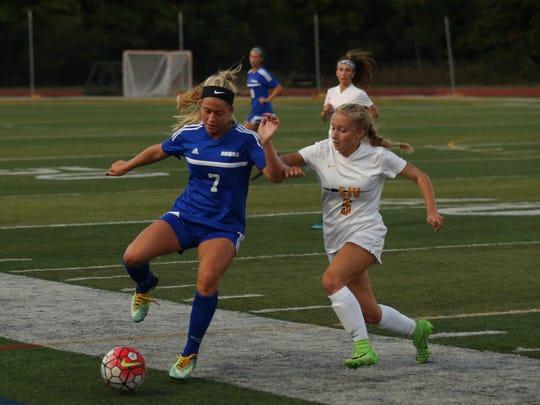 Shore's Frankie McDonough and SJV's Chloe Sherman battle for ball during first half action. Shore Regional Girls Soccer vs St. John Vianney in Holmdel NJ on September 20, 2017