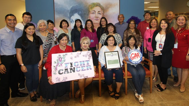 "On April 5, 2018, Guam Power Authority general manager John M. Benavente, P.E., management and GPA staff signed a ""Join the Fight"" pledge in support of Guam Cancer Care. The effort underscores GPA's commitment to join in the fight against cancer and to work towards promoting a healthier workforce and island. Standing back row from left: William Mafnas, Sylvia Ipanag, Eileen Gimeno, Cora Montellano, Beatrice Limtiaco, Julie Quinata, John Benavente, John Cruz Jr., Gerald Smith. Standing middle row from left: Jon-Rey Aguigui, Rhythm-Armani Blas (cancer outreach coordinator), Bernadette Sablan, Sandra Perez, Cecilia Fejeran-Unpingco, Selma Blas, Candice Ananich, Patricia Diego. Front row from left: Anita Fejerang, Gabina Ignacio, Lenora Sanz, and Filipinas Torres."