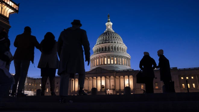Night falls on the Capitol in Washington on Wednesday during the impeachment trial of President Donald Trump. For all the gravity of a presidential impeachment trial, Americans don't seem to be giving it much weight.