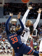 Auburn guard Janiah McKay (33) and Mississippi State guard Roshunda Johnson (11) scramble for a rebound during the second half of an NCAA college basketball game in Starkville, Miss., Thursday, Feb. 22, 2018. Mississippi State won 82-61. (AP Photo/Rogelio V. Solis)