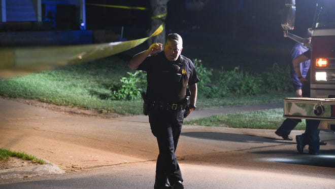 Authorities investigate a crime scene Friday night in Clive.