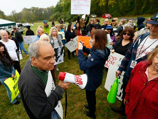Protester Bill Craine of Poughquag, NY talks to fellow