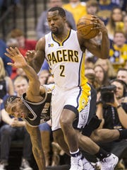 Rodney Stuckey of Indiana, comes up with a loose ball