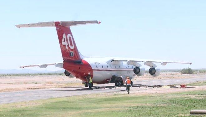 A Neptune aircraft is refueling with fire retardant before taking off again at the Alamogordo-White Sands Regional Airport. Neptune has been assisting the U.S. Forest Service at the Dog Head fire that's southeast of Albuquerque.