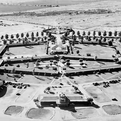 "Construction of Thunderbird Field began in 1941. The airfield was part of the U.S. Army's Civilian Pilot Training Program, whose goal was to increase the number of trained pilots in America in case the country became involved in the war raging at the time in Europe. Thunderbird was a civilian contract school operated by Southwest Airways and supervised by army air force personnel. The first class of cadets, 57 strong, arrived in March 1941. They received 65 hours of flying training and 109 hours of ground-school instruction over a period of nine weeks. After that, they may have gone on to more advanced training at another airfield. By the time Thunderbird closed in June 1945, more than 10,000 men and trained there, as well as 15 classes of Chinese Air Force cadets. The plane they learned in was the bi-wing Boeing PT-17, popularly known as the ""Stearman."" In this 1946 image of the field, the resemblance of the building layout to the Native American concept of the mythical thunderbird can be seen. At the bottom, the control tower forms part of the tail of the thunderbird."