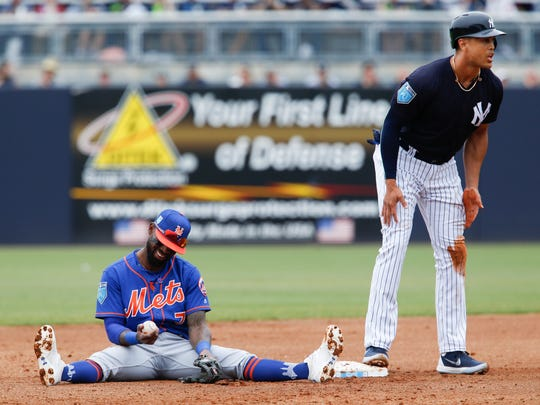 New York Mets shortstop Jose Reyes (7) reacts after the call where New York Yankees player Giancarlo Stanton (right) is safe at second base during the bottom of the first inning at George M. Steinbrenner Field.