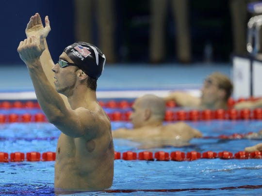United States' Michael Phelps celebrates winning the gold medal in the men's 200-meter butterfly during the swimming competitions at the 2016 Summer Olympics, Tuesday, Aug. 9, 2016, in Rio de Janeiro, Brazil. (AP Photo/David J. Phillip)