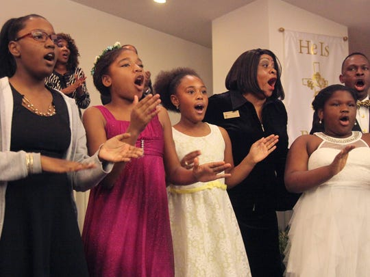 Members of the City of Fort Myers Housing Authority Youth Choir entertain visitors to the Jesus Christ Outreach Center during the Dr. Martin Luther King Jr. Commemorative Ecumenical Service on Sunday evening.