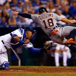 Tyler Collins of the Detroit Tigers is tagged out at home plate by Salvador Perez of the Kansas City Royals during the game at Kauffman Stadium on Tuesday night.
