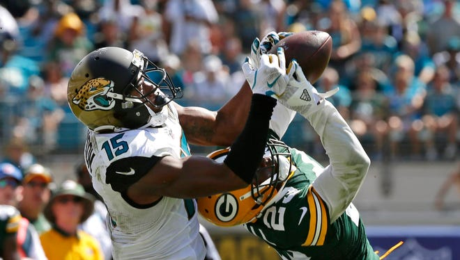Jacksonville Jaguars wide receiver Allen Robinson (15) has his pass broken up by Green Bay Packers cornerback Damarious Randall (23) at Everbank Field..