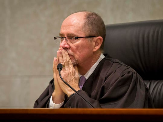 Justice Daryl L. Hecht listens to lawyers during oral