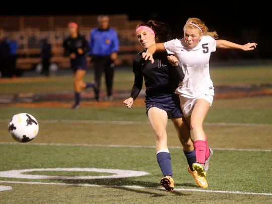 Aztec's Autumn Petersen, right, fights off Piedra Vista's Aspyn Tracy for a loose ball on Oct. 6, 2015 at Fred Cook Memorial Stadium in Aztec.