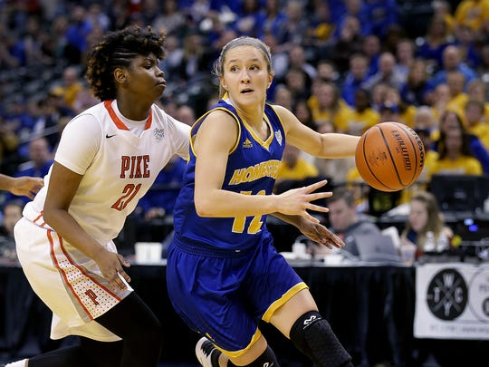 Homestead's Karissa McLaughlin (12) drives around Pike's Michaela White (21) in the IHSAA 4A Girls Basketball State Finals, Feb. 25, 2017.
