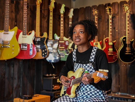 Guitarist Melanie Faye checks out guitars at Eastside