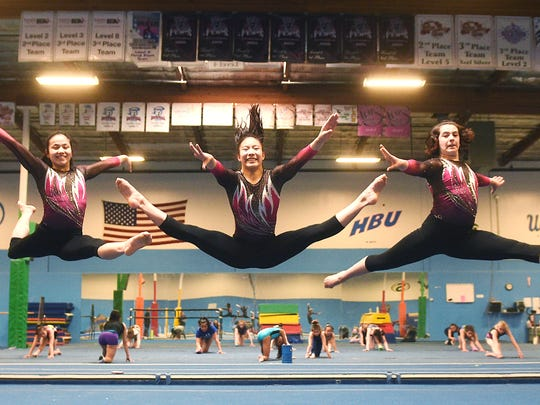 From left, Lily Reid, Malia Hargrove, Esther Ro, Alexia Burch and Emily Erb jump for a portrait at Flips USA Gymnastics in Sparks on April 25.