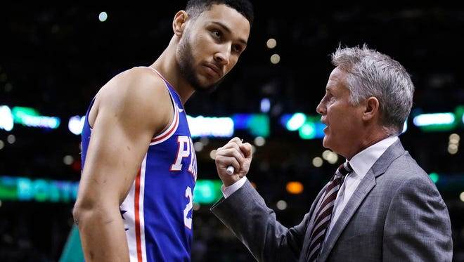 Sixers guard Ben Simmons consults with head coach Brett Brown during the Sixers' 114-112 loss in Game 5 of the Eastern Conference semifinals on Wednesday.