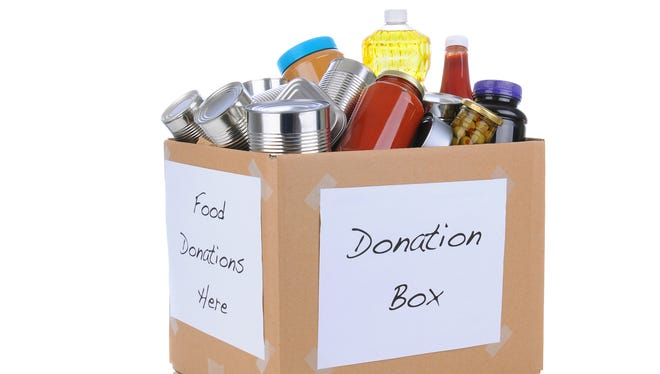 A box full of canned and packaged food for a donation.