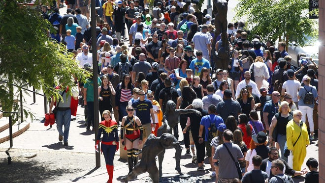 Long lines wrap around the block at Comicon on Friday, May 26, 2017 at Phoenix Convention Center. New security measures are in place after the arrest of an armed man at the event on Thursday.