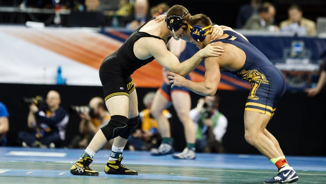 Iowa's Nathan Burak wrestles WVU's Jacob A. Smith during their second round NCAA Championship bout on Thursday in New York.