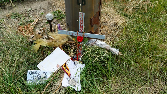 A memorial to West Lafayette High School student Christian Burns Wednesday, June 15, 2016, off County Road 700 S near Chalmers. Burns, 17, died in a car accident at the scene on May 31.