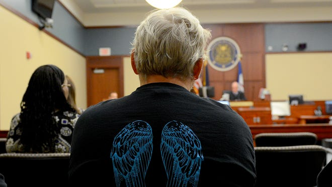 James Lo Tempio, a volunteer with Homeless Angels, listens to the proceedings in Ingham County Judge James Jamo's courtroom last month during a hearing about a request from the city of Lansing for a temporary restraining order against the owner of the Magnuson Hotel. The owner has since filed a counter suit against the city and Homeless Angels.